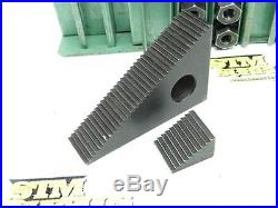 ASSORTED LOT OF STEP BLOCKS HOLD DOWN STRAPS AND NUTS