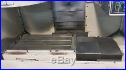 Mitsubishi V360 Vertical CNC Mill with tool holders and book